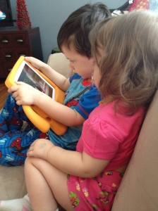 Sharing the iPad and loving on each other.