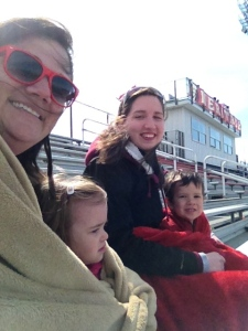 Huddled on the bleachers at the lax game.
